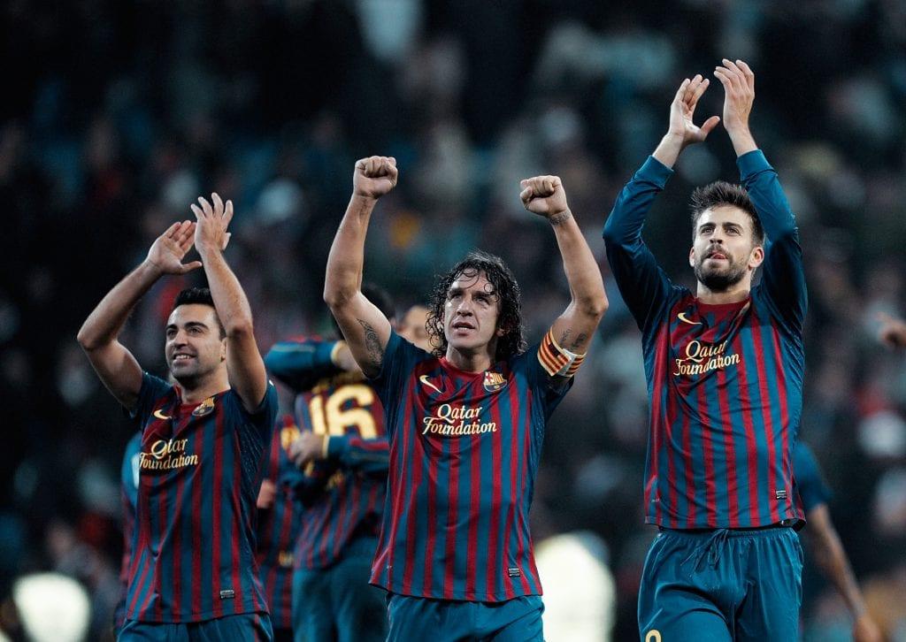 Xavi Hernández Carles Puyol Gerard Piqué Barcelona defence Johan Cruyff